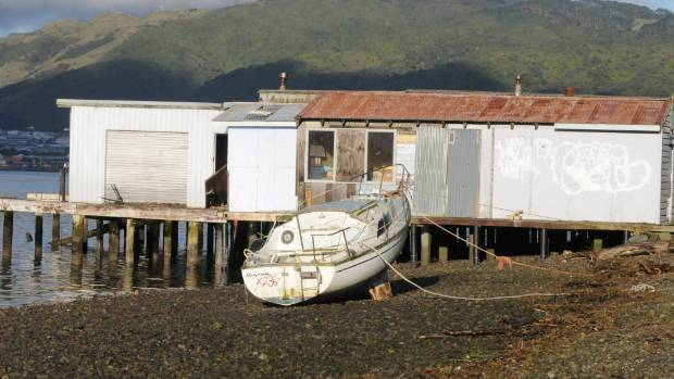 An unidentified white bilge keeler broke away from the Onepoto boatsheds in Titahi Bay, Porirua during last week's ...