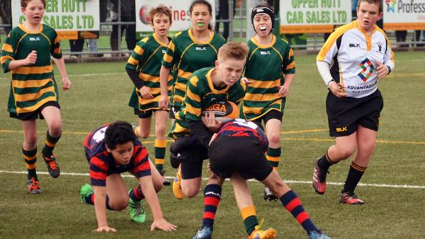Hutt Valley under-12 rugby captain Thomas Devery drives into the tackle of a Horowhenua Kapiti opponent in the three-day ...