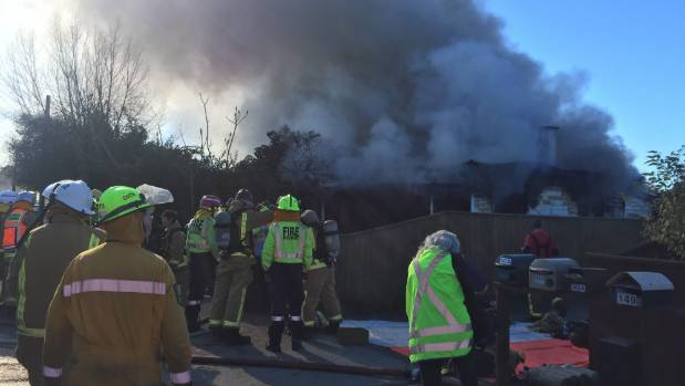 Emergency services attend the scene of the fire on Tuesday morning.
