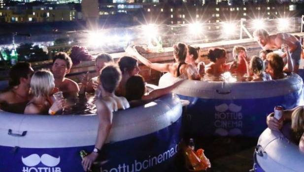Staff serve food and drink during the movie and there's a lifeguard on standby at Hot Tub Cinema in Sydney.