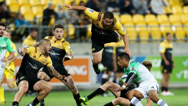 Dane Coles is headed for a thud, alongside Hurricanes team-mates TJ Perenara and Beuaden Barrett, during his most recent ...
