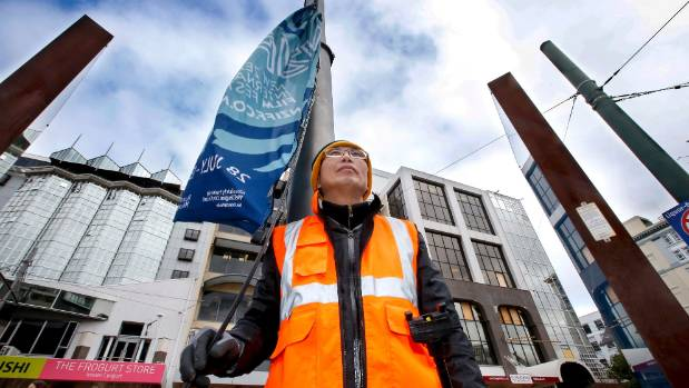 Wellington City Council contractor Alex Tan is part of the team who put up the city' event flags, usually in the dead of ...