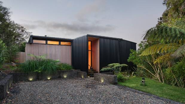 The gravel driveway references the area's metal roads, and Steve poured the retaining walls to look like they've just ...