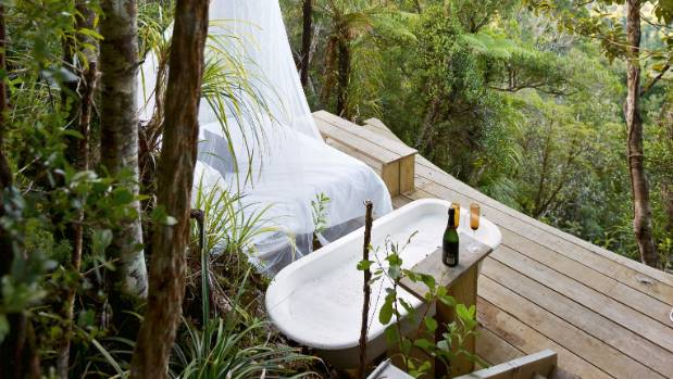 The outdoor bath has instant gas hot water; Steve and Linda occasionally spend the night in the day bed when the ...