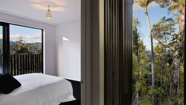 One of two guest rooms; the bars on the deck are perfectly spaced to allow guests to enjoy the view, but they provide ...