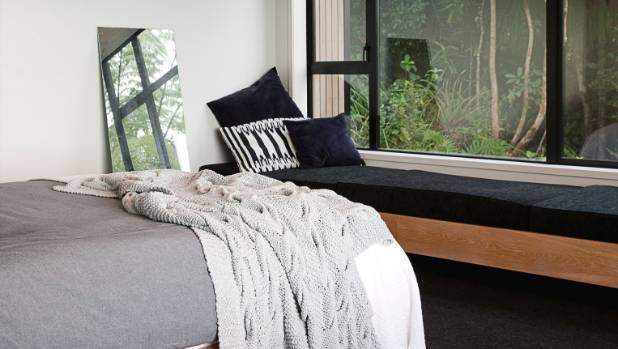 Steve built the bed base and bench seating in the master bedroom; there are sunscreen and blackout blinds on tracks in ...