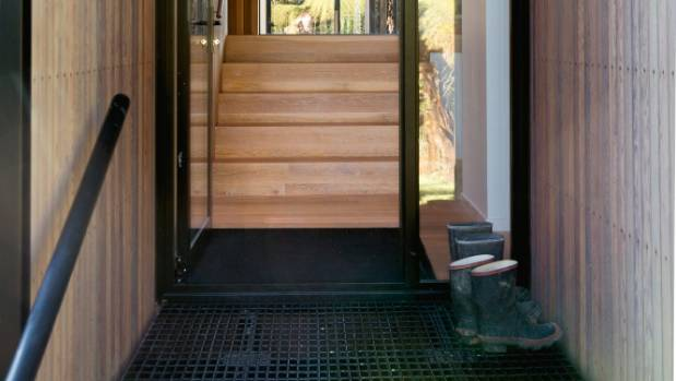 The steel grille front doorstep is designed to prevent gravel from the driveway being brought indoors; there is always a ...