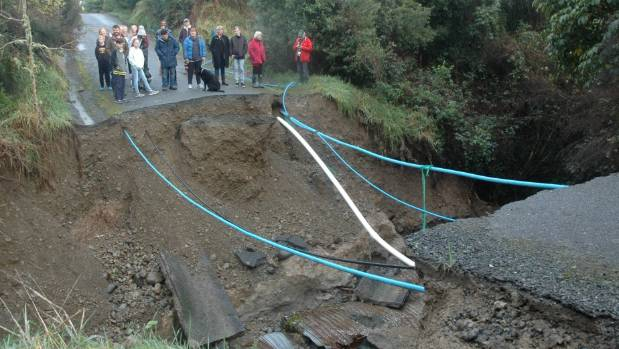 "Maymorn residents take in the scale of the storm damage to their private driveway. ""A big pot hole appeared and then ..."