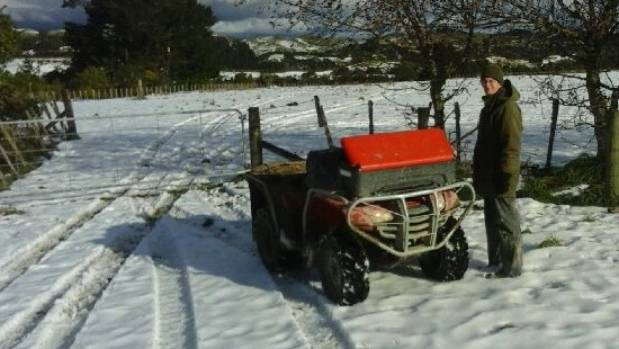 Pohangina Valley farmer Tony Gray waits for the snow to clear and lights to come back on four days after a big snowstorm ...