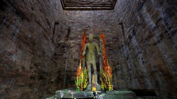 A religious figure is seen inside Sambor Prei Kuk.