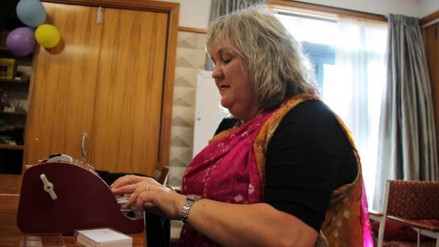 Julie Woods aka 'that blind woman' of Dunedin at work on her braille typewriter.