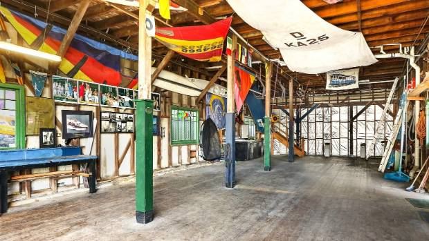 The building, which dates back to 1910, is a classic boatshed style.