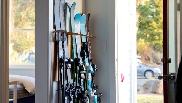 Skis drip-dry by the front door.