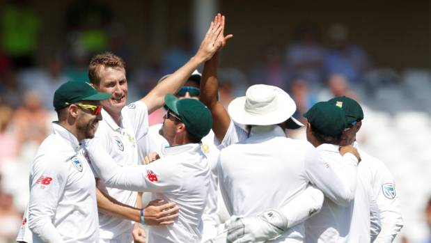 South Africa's Chris Morris celebrates the wicket of England's Alastair Cook with teammates.