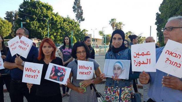 A group in Ramle, Israel, gathers to protest the death of Henriette Karra last month.