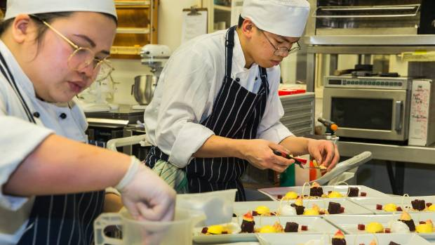 Ara student chefs Denice Marayag and Edsant Obillo, both 22, carrying out their seventh trial run of their three course ...