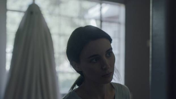 Rooney Mara, and yes, that is Casey Affleck under the sheet, star in A Ghost Story.