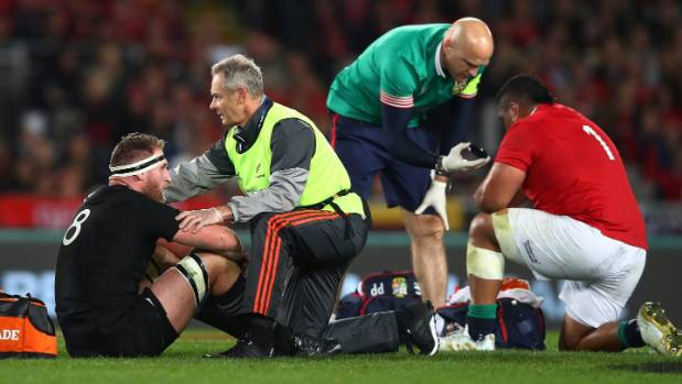 Kieran Read of the All Blacks and Mako Vunipola of the Lions receive treatment during the third test match between the ...