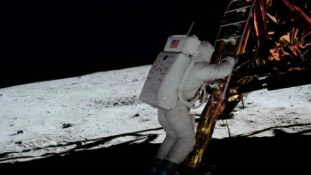 Astronaut Edwin Aldrin shows up brightly in this image from the Apollo 11 mission, even though he's completely in the ...