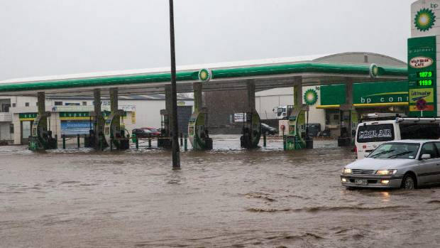 Flood water filled the petrol station forecourt.
