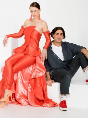 Fashion designer Youhan Khosho, 20, with his Resene Fugitive garment to be showed on the Resene Designer Runway in three ...