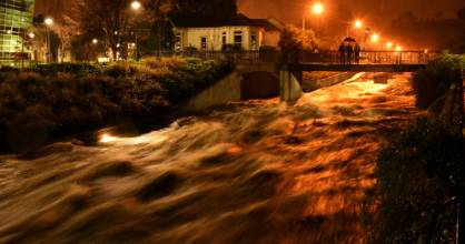 Water rushes under the Leith Footbridge, in Dunedin, about 11pm on Friday.