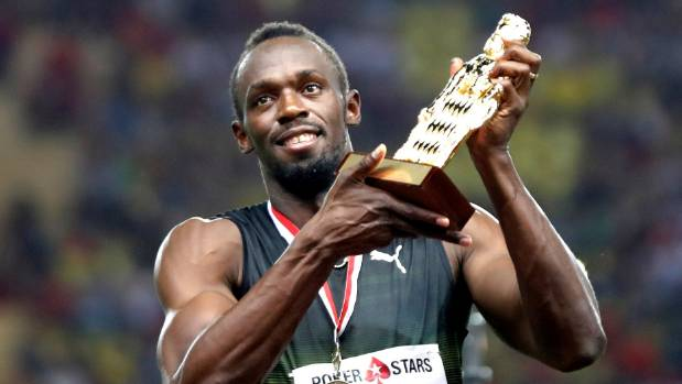 Yip, he's still got it. Usain Bolt lifts the trophy won for victory in the men's 100m at the Monaco Diamond League.