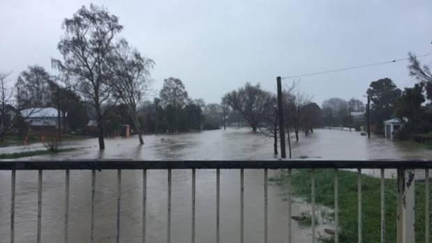 The flooded Heathcote River, at Opawa.