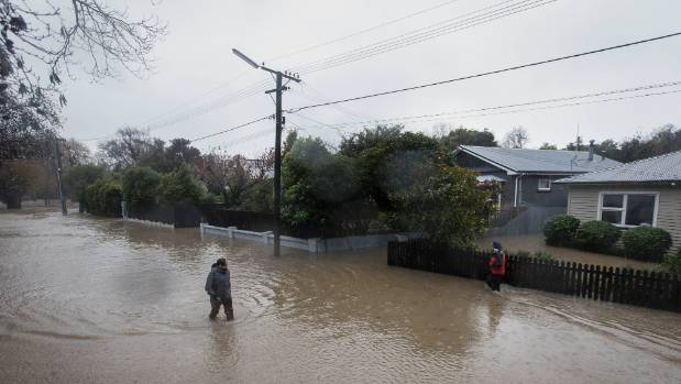 Sloane Tce residents are knee-deep in water.