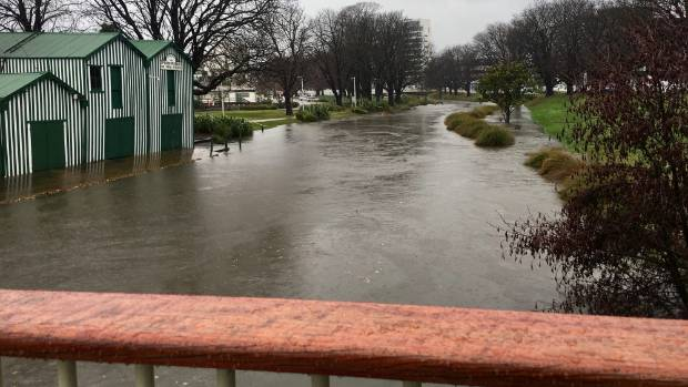 Flooding surrounds the Boat Shed on the Avon River in Christchurch.