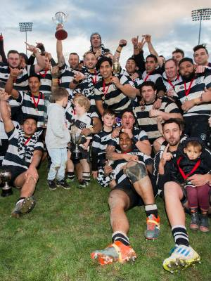 The Moutere division one team celebrate success in the Marlborough division one grand final, at Lansdowne Park on Saturday.