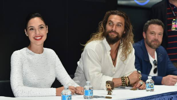 Actors Gal Gadot, Jason Momoa and Ben Affleck during the Justice League autograph signing at Comic-Con International 2017.