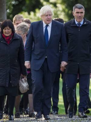 British Foreign Secretary Boris Johnson (centre) arrives at Takahanga Marae in Kaikoura about 9am on Monday with Civil ...