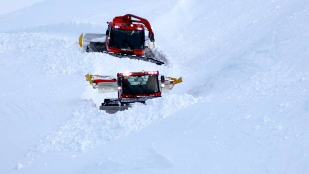 A photo from Mt Hutt ski area's Facebook page shows groomers working in fresh snow.