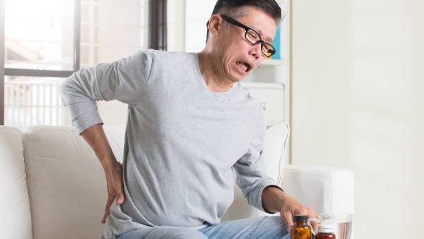 Most back pain resolves with rest, anti-inflammatory medication - and continuing to move. Sitting can make it worse.