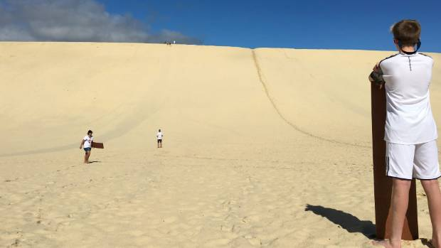 Sledding down the sand dunes was The Teenager's favourite activity.