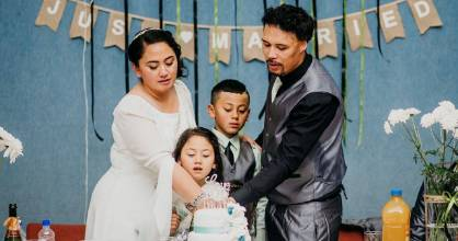 Elaine and Daniel Milo's children Lalakai, 9, and Lorielle, 6, served as groomsman and bridesmaid at the wedding.