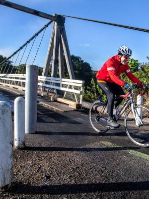 A cyclist has absolutely no problems with the new width restrictions at the Bertrand Rd suspension bridge.