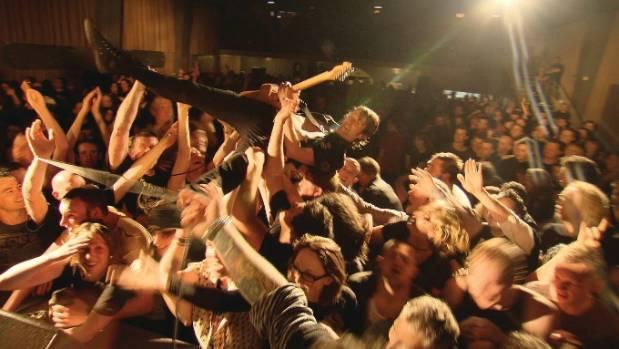 Head Like a Hole guitarist Nigel Regan crowd surfs during a Wellington show.