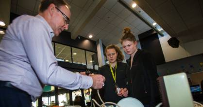 Brian Best of Massey University shows first-year students Hayley Maher, left, and Ashley Purdie how to identify faulty ...
