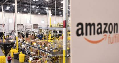 Workers process incoming items at an Amazon Fulfillment Center on Cyber Monday in Tracy, California, U.S. November 28, ...