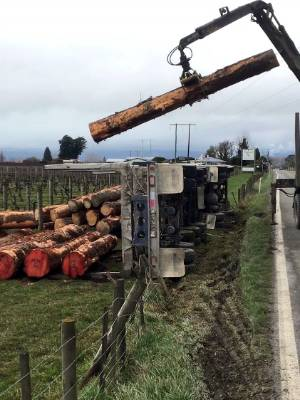 A logging truck overturned at Appleby near Nelson.