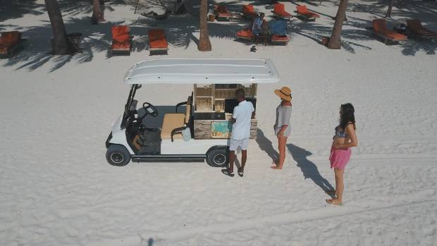 The resort's new drink buggy sometimes gets stuck in the sand if it's too weighed down with cocktails. You'd better help ...