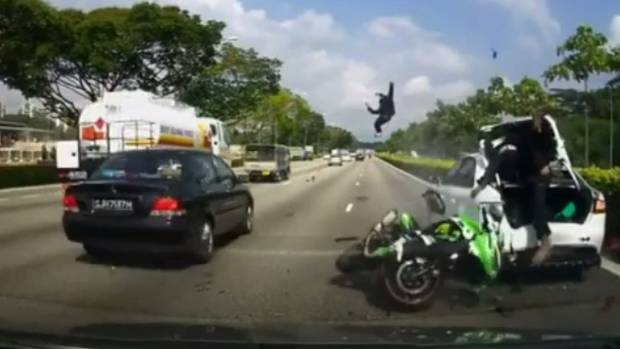 A pillion passenger flies through the air after a rear-end motorcycle crash in Singapore.