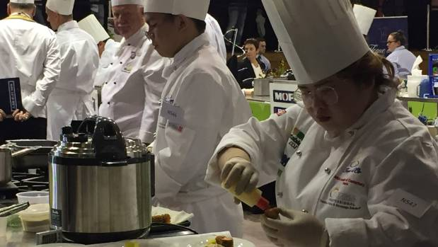 Timaru cooking students Ed Obillo, 22, centre and Denice Mayarag, 22, far right, competing in the Nestle Toque D'Or on ...