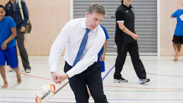 National leader and PM Bill English drops the ball during a visit to a South Auckland primary school.
