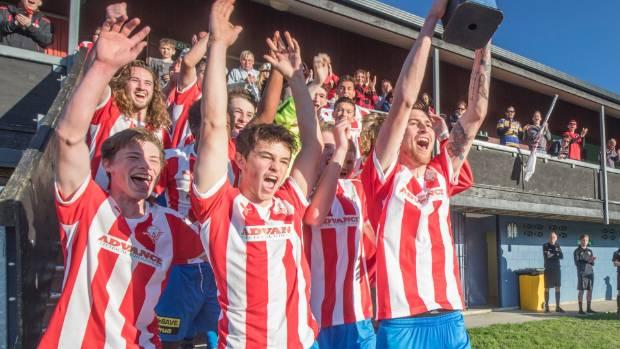 Western Suburbs captain Harry Edge lifts the Central League trophy at Endeavour Park on Sunday.