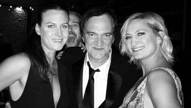 Angela Merrie, left, with Quentin Tarantino and Zoe Bell, at the premiere of The Hateful Eight.