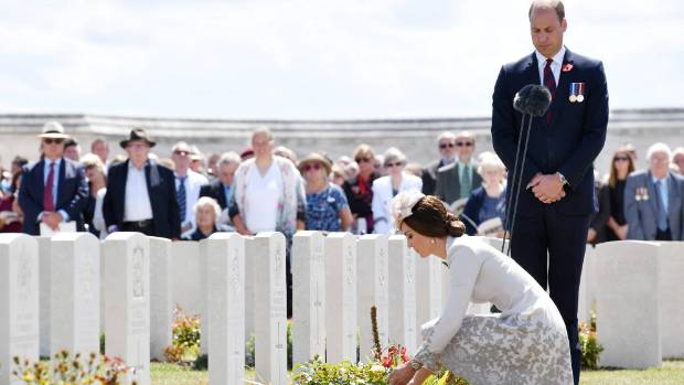Prince William watches Catherine Duchess of Cambridge lays flowers during commemorations of the start of the Allied ...