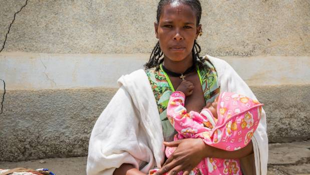 Mihret Breast feeds her six month old son Dawit at Kihen Health Post in Kilte Awlaelo Woreda in Ethiopia, Africa. Unicef ...